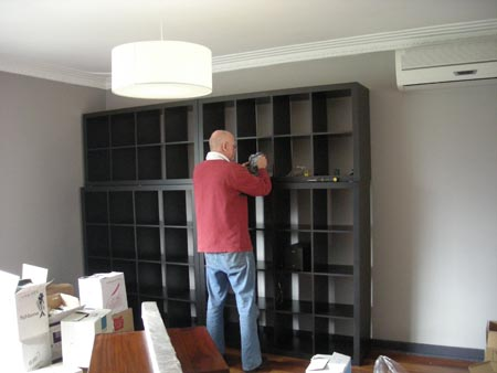 DIY Dad finessing the shelves on the wall